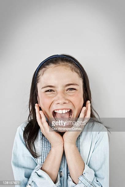 Portrait of screaming girl (10-12), studio shot