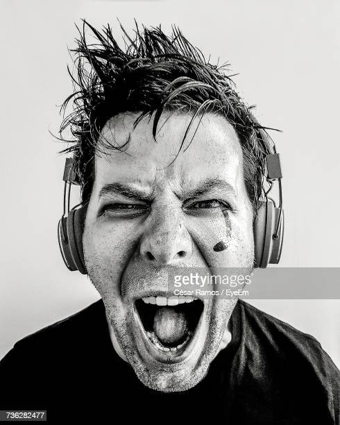 Portrait Of Screaming Man Wearing Headphones