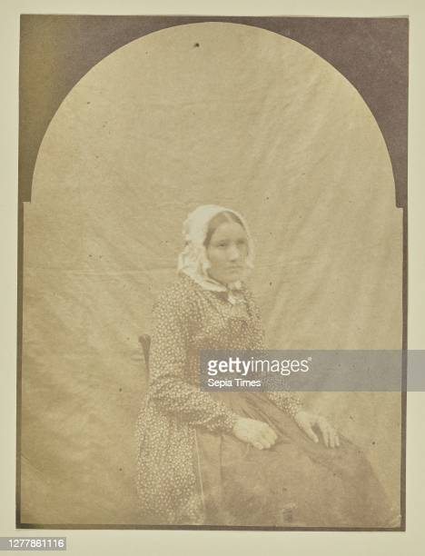 Portrait of seated woman with a bonnet; Hippolyte Bayard ; about 1840 - 1849; Salted paper print; 16.1 x 12.1 cm .