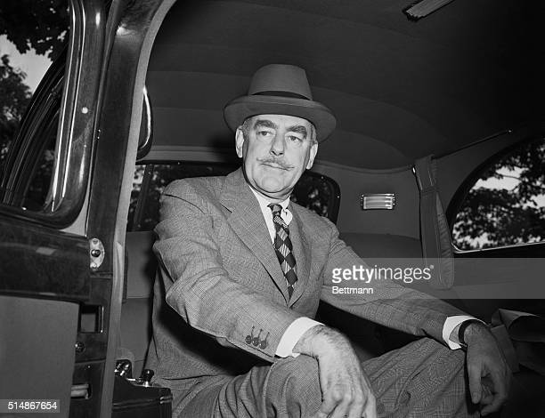 Portrait of Secretary of State Dean Acheson seated inside automobile. Photo circa 1950.