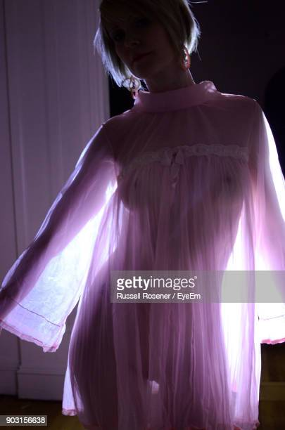 portrait of seductive woman in nightie standing at home - women in slips stock pictures, royalty-free photos & images