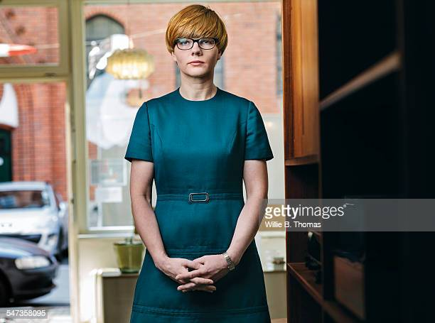 portrait of self-confidence woman - green dress stock pictures, royalty-free photos & images