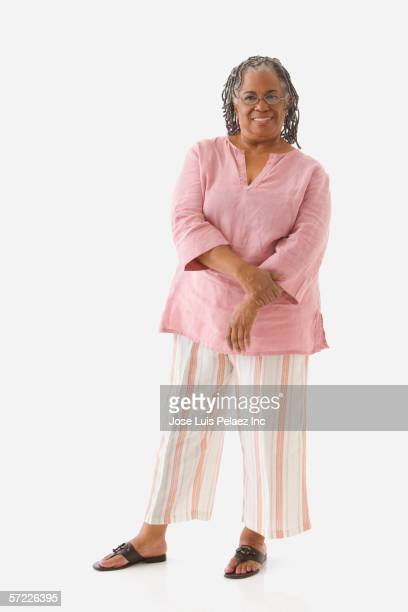 portrait of senior adult woman standing - full length stock pictures, royalty-free photos & images