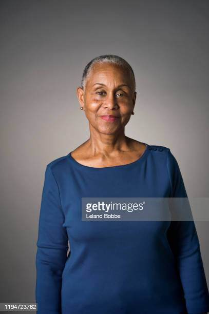 portrait of senior african american woman - women stock pictures, royalty-free photos & images