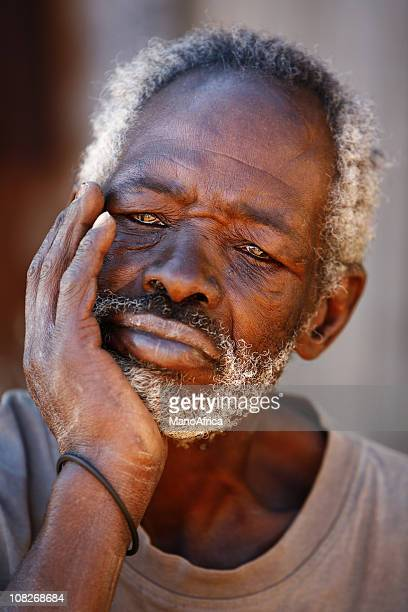 Portrait of Senior African Man Resting Chin in Hand