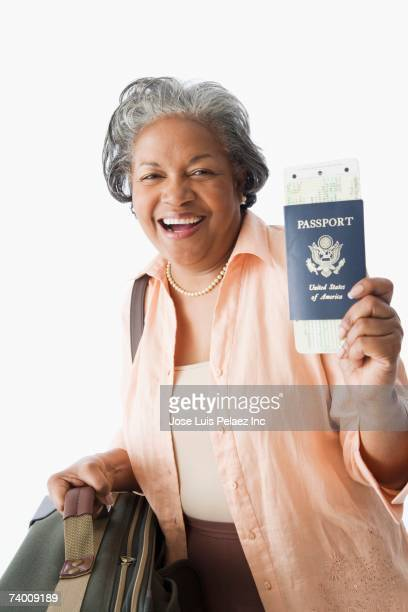 Portrait of senior African woman holding passport