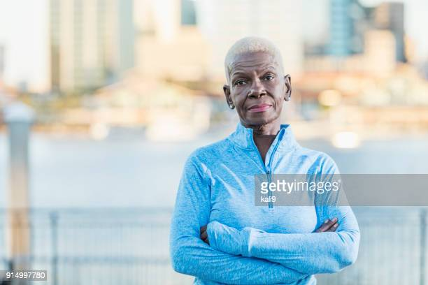 portrait of senior african-american woman outdoors - toughness stock pictures, royalty-free photos & images