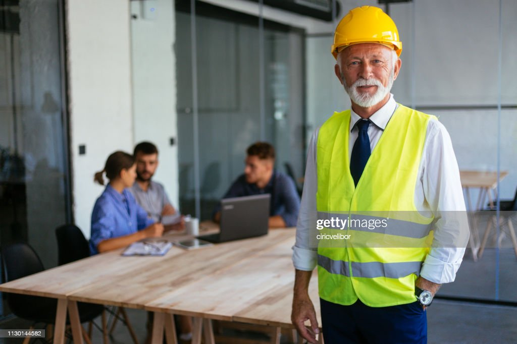Portrait of senior architect at the office : Stock Photo