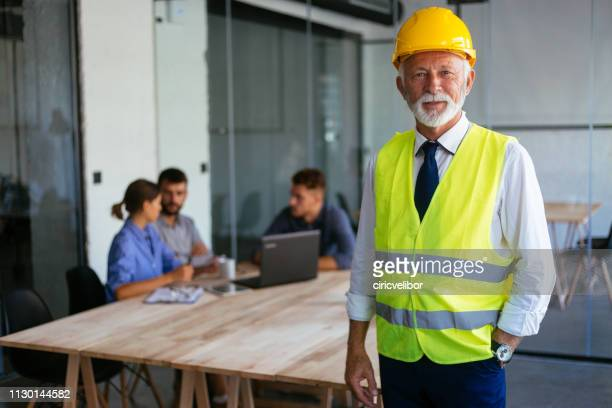 portrait of senior architect at the office - waistcoat stock photos and pictures