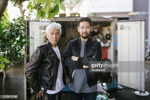 portrait of senior asian man with his son - biker jacket stock pictures, royalty-free photos & images
