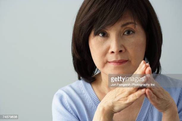 portrait of senior asian woman - asian 50 to 55 years old woman stock photos and pictures