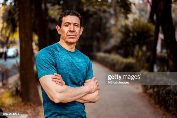 portrait of senior athlete - t shirt stock pictures, royalty-free photos & images