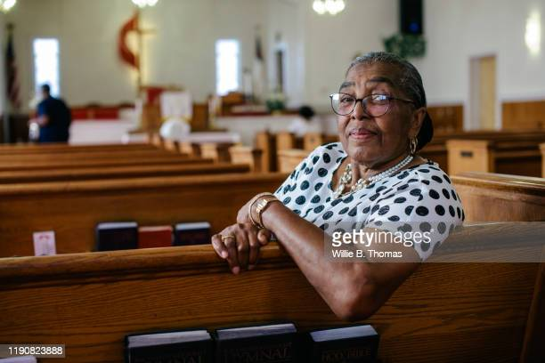 "portrait of senior black woman sitting in church""n - place of worship stock pictures, royalty-free photos & images"