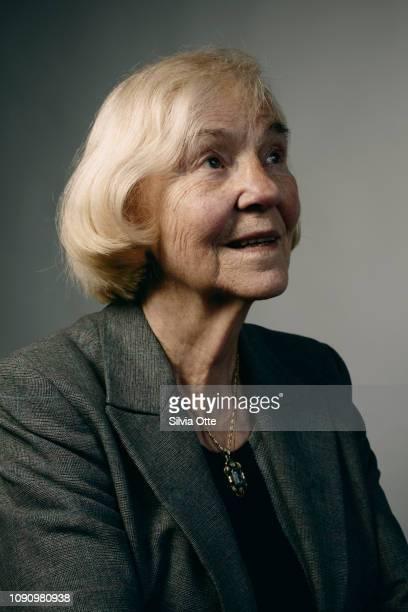 Portrait of senior blonde woman looking up