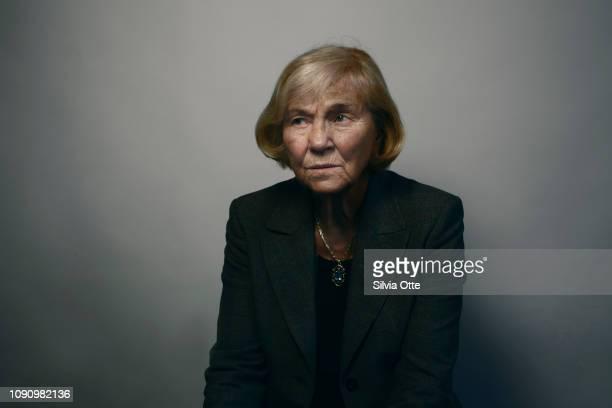 Portrait of senior business woman looking distrustful