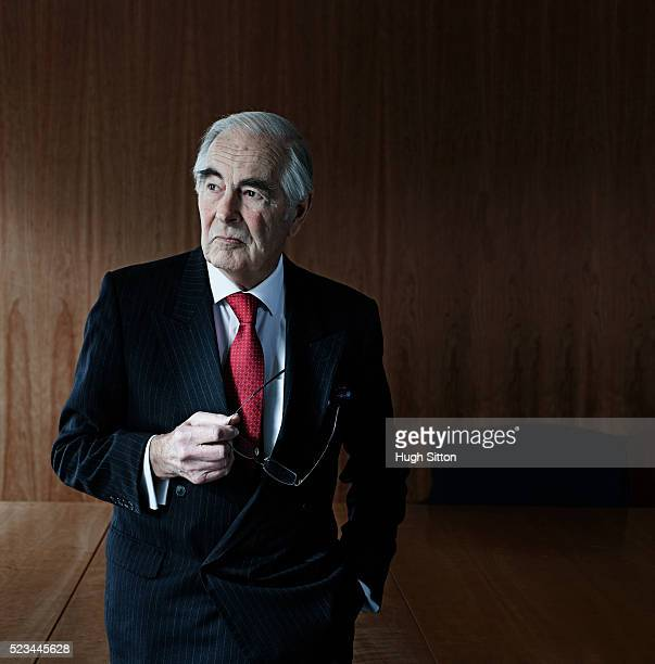 portrait of senior businessman in boardroom - hugh sitton stock pictures, royalty-free photos & images