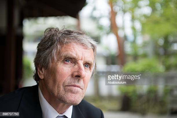 portrait of senior businessman in buddhist temple, kyoto, japan, asia - well dressed stock pictures, royalty-free photos & images