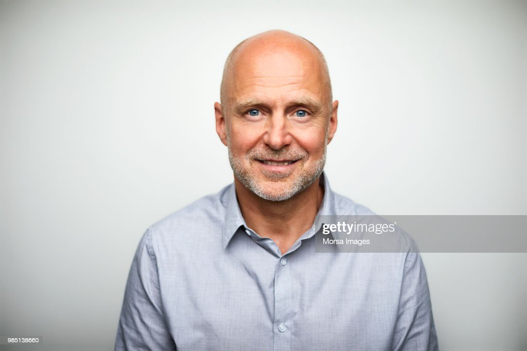 Portrait of senior businessman smiling : Stock Photo