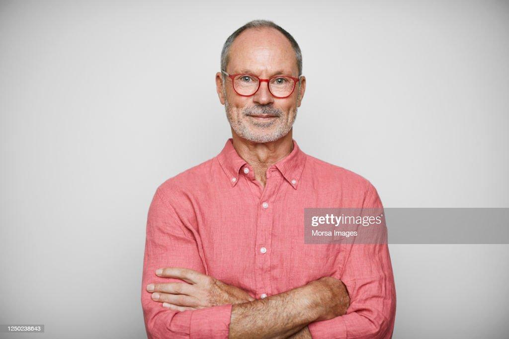 Portrait Of Senior Businessman Wearing Shirt : Foto de stock