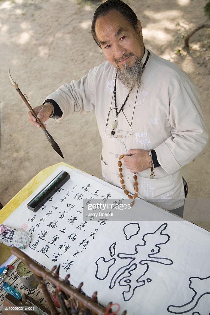 Portrait of senior calligrapher : Stockfoto