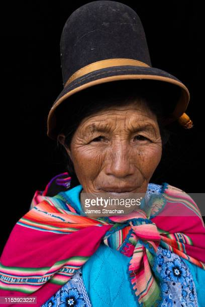 portrait of senior cholita, with weather-beaten face, in colourful traditional clothes and bowler hat, sun island, lake titicaca, bolivia (model release) - james strachan stock pictures, royalty-free photos & images