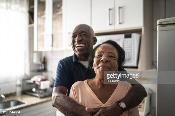 portrait of senior couple at home - wife stock pictures, royalty-free photos & images