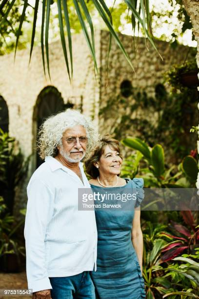Portrait of senior couple embracing in backyard garden