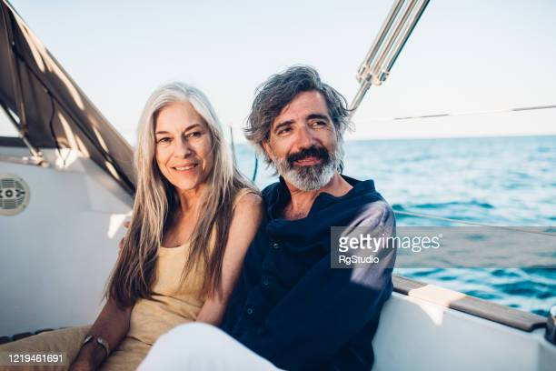 portrait of senior couple enjoying on their yacht - high society stock pictures, royalty-free photos & images