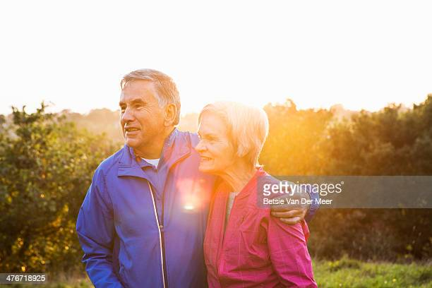 Portrait of senior couple in running gear outdoors