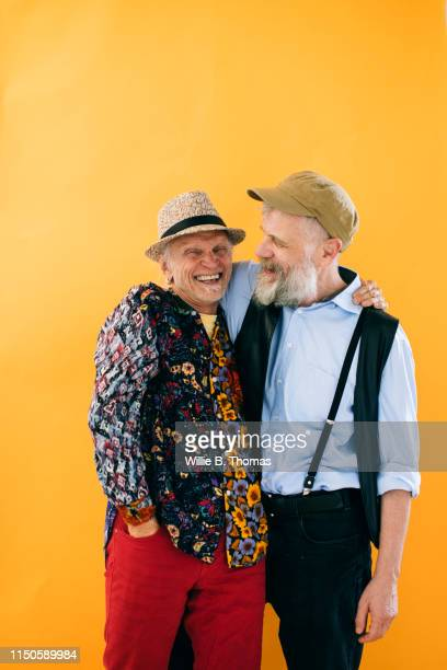 portrait of senior couple on a colorful background - union gay fotografías e imágenes de stock