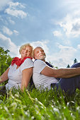 portrait senior couple sitting field