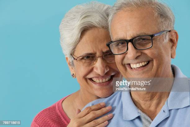 portrait of senior couple smiling - indian couples stock pictures, royalty-free photos & images
