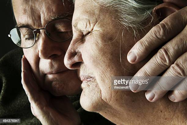 portrait of senior couple with close eyes, close-up - alzheimer's disease stock pictures, royalty-free photos & images