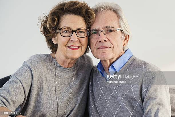 """portrait of senior couple with heads touching. - """"martine doucet"""" or martinedoucet foto e immagini stock"""