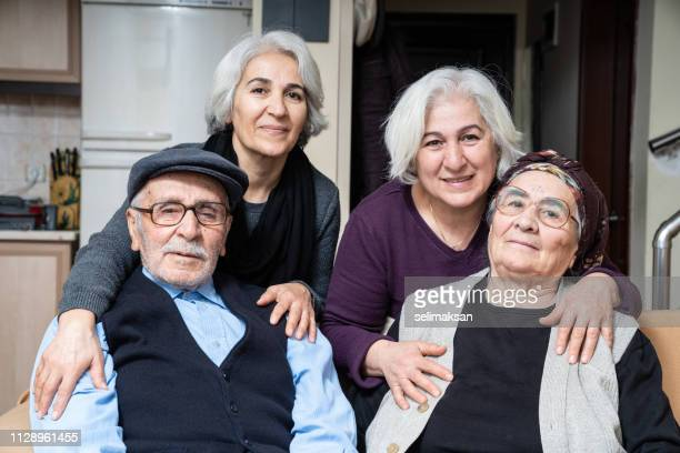 Portrait Of Senior Couple With Senior Daughters