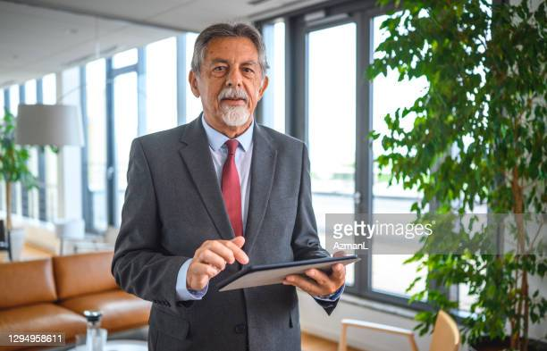 portrait of senior executive using digital tablet in office - goatee stock pictures, royalty-free photos & images