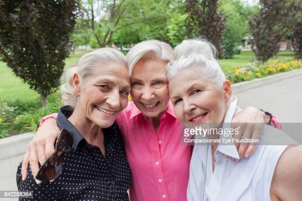 Portrait of senior friends in park