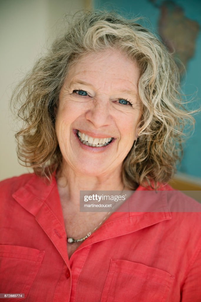 Portrait of senior gray haired woman smiling. : Stock Photo