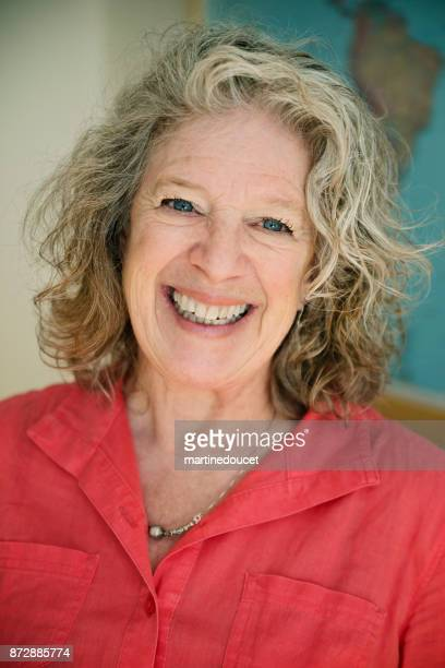 Portrait of senior gray haired woman smiling.