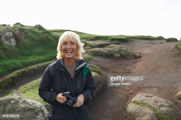 portrait of senior hiking woman laughing. - mid length hair stock pictures, royalty-free photos & images