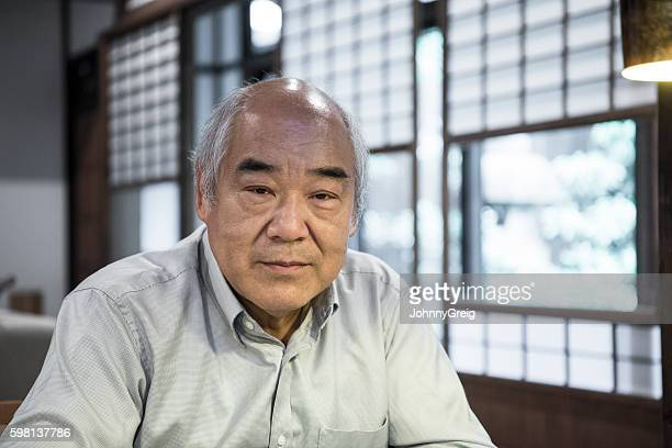 Portrait of Senior Japanese man looking towards camera