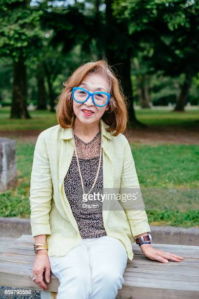 Portrait of senior Japanese woman with funny eyewear