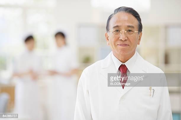 Portrait of senior male doctor