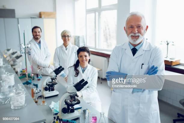 Portrait of senior male scientist posing in lab