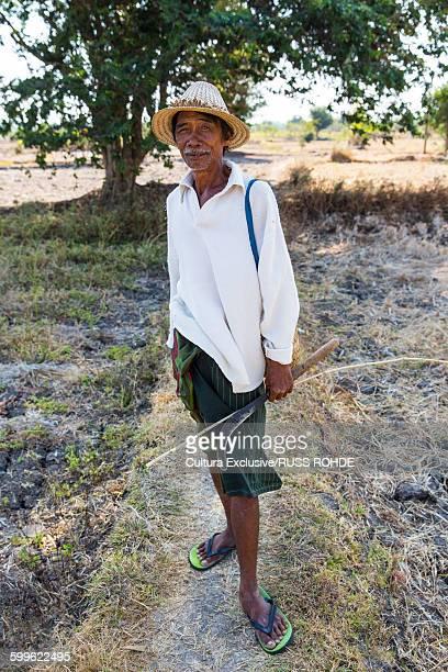 Portrait of senior male shepherd in field, Lombok, Indonesia