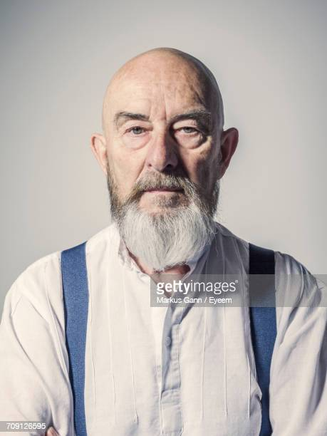 portrait of senior man against white background - beard stock pictures, royalty-free photos & images