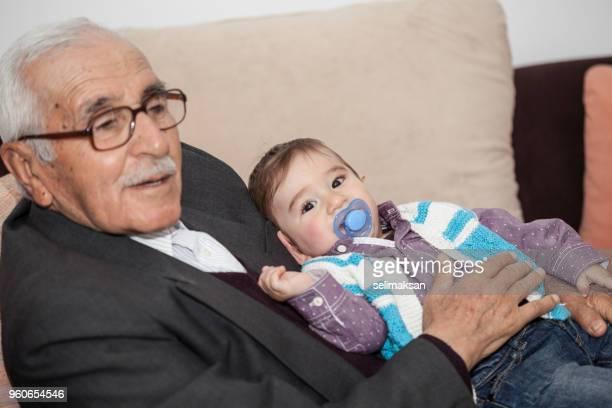 Portrait Of Senior Man And Grandchild