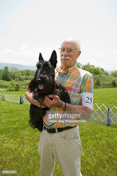Portrait of senior man and his dog at dog show