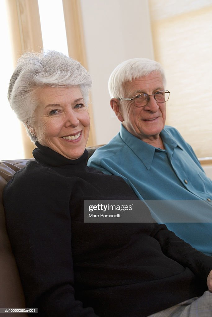 Portrait of senior man and woman sitting : Foto stock