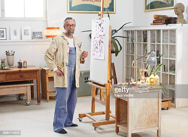 Portrait of senior man at his home art studio